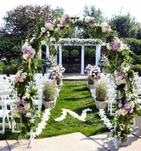 beautiful arch greenery wedding