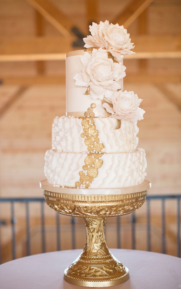 charming wedding cake with gold garnish