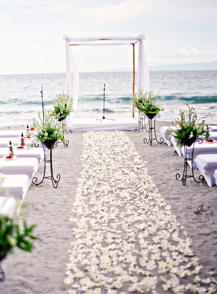 white beach wedding aisle decor