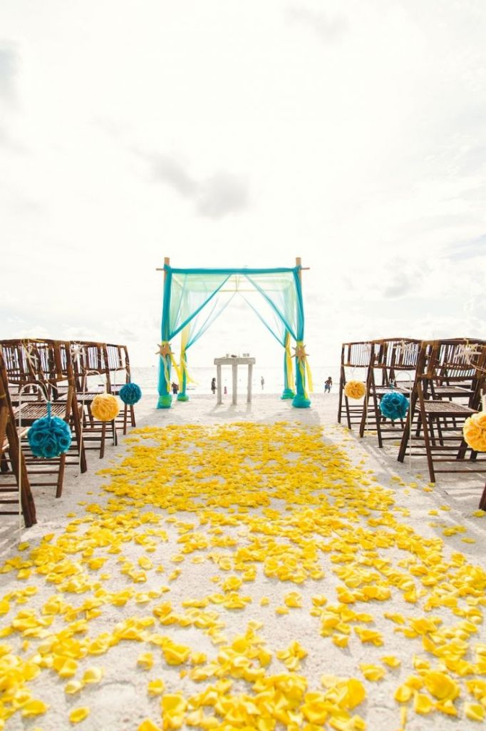blue and yellow wedding aisle