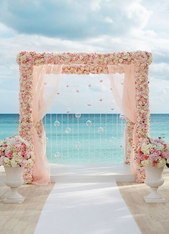 pink theme beach wedding aisle