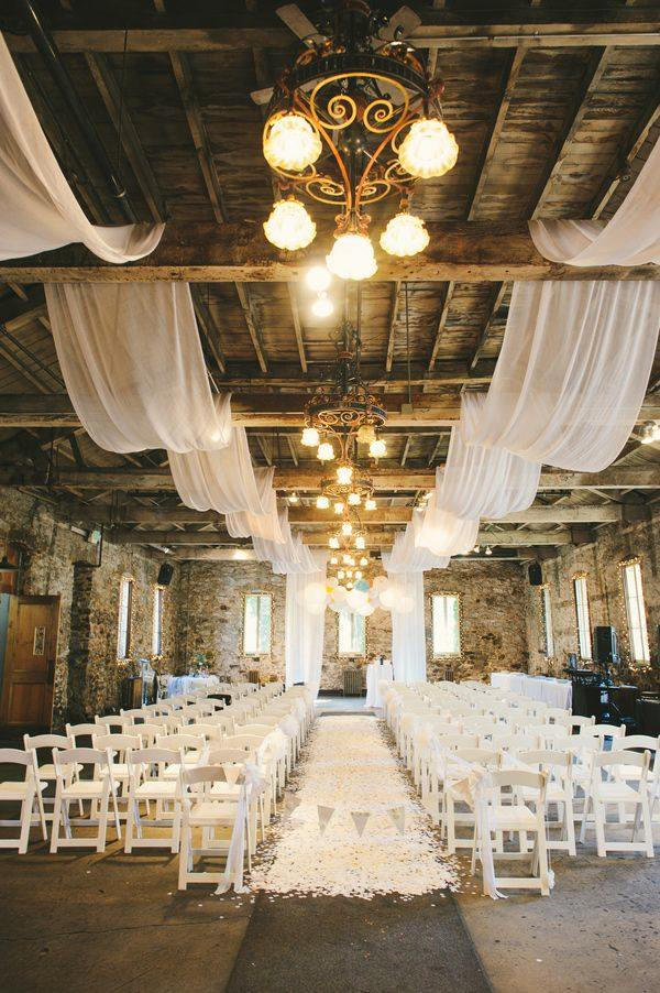 Awesome indoor wedding ceremony with vintage and beautiful elegant wedding invites romantic indoor barn wedding ceremonies with lights junglespirit Images