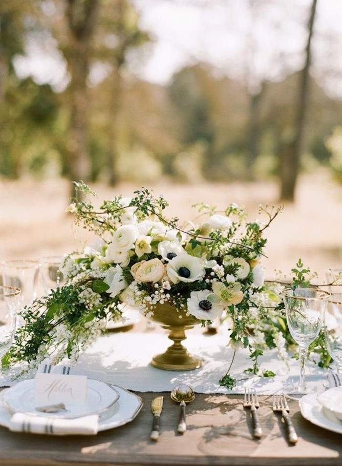 neatly table set for rustic wedding