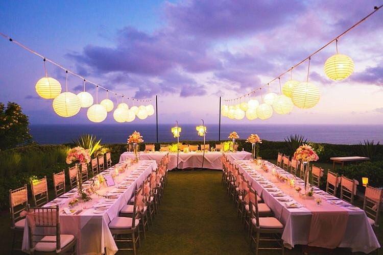 night beach wedding with lantern