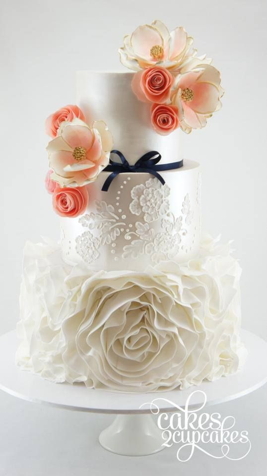 chic elegant wedding cake with flower topping