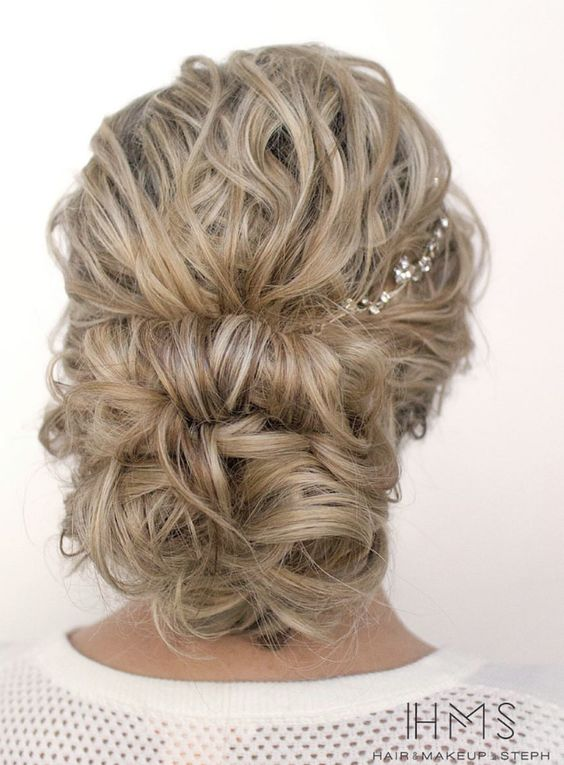 elegant curly wedding hairstyle for brides