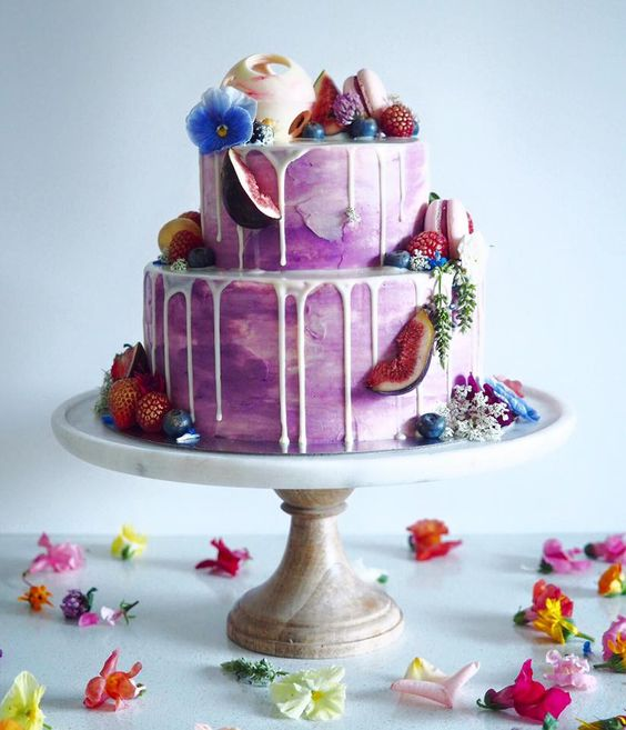 small purple wedding cake with fruit topping