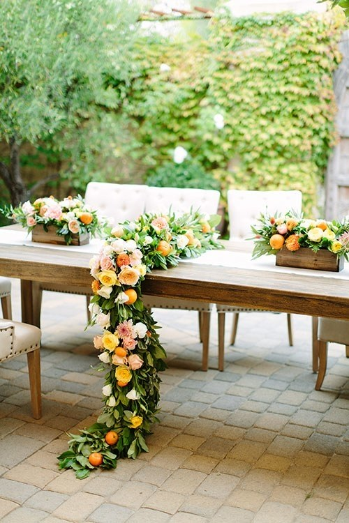 table garland greenery with citrus fruits