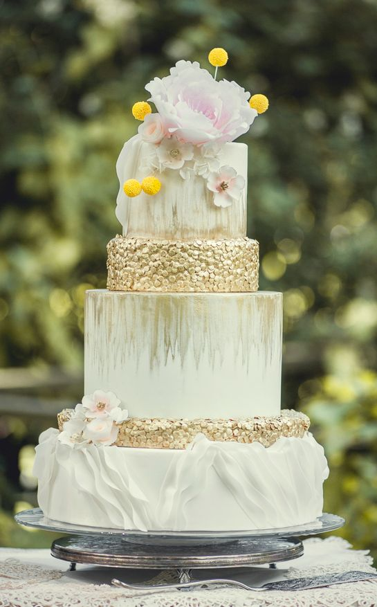 white chic wedding cake with sugar oat topping