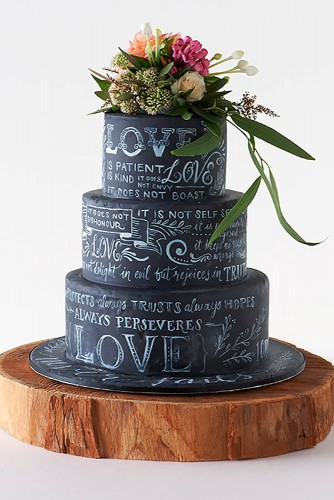 black wedding cake with floral topping