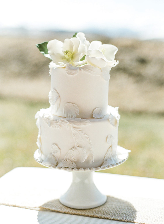 small wedding cake with feather